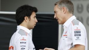 Sergio Perez in conversation with Martin Whitmarsh.